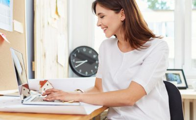 Young successful business owner filing IRS Form 7004 to extend her business tax return deadline